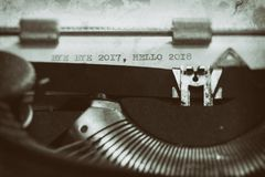 Vintage typewriter with a text. Typewriter with the phrase, Happy 2018 and goodbye to 2017 Royalty Free Stock Photos