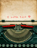 Vintage typewriter with textured grungy paper. I love You. Vintage typewriter with aged textured grungy paper. Sample text I love You! Valentines Day concept Stock Photography