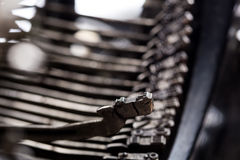 Vintage typewriter type bars closeup photo Stock Photos
