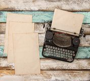 Vintage typewriter used paper sheets Flat lay still life. Vintage typewriter and used paper sheets on wooden background. Flat lay still life stock photo