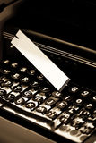 Vintage typewriter and white tag Royalty Free Stock Photo