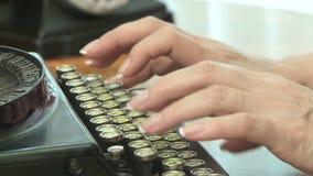 Vintage Typewriter. Woman typing on a vintage typewriter, close up stock video
