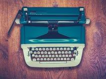 Vintage Typewriter On Wooden Background Stock Photo