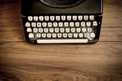 Vintage Typewriter. A Vintage Typewriter on a wooden table stock photos