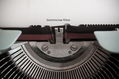 Vintage typewriter with words - Curriculum Vitae Stock Image