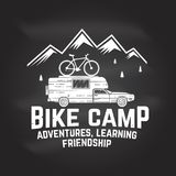 Vintage typography design with car and trailer, mountain bikes and mountain silhouette. Stock Photos