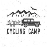 Vintage typography design with car and trailer, mountain bikes and mountain silhouette. Stock Images