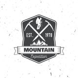 Vintage typography design with ice ax and mountain silhouette. Stock Photos
