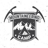 Vintage typography design with ice ax and mountain silhouette. Mountaineering camp badge. Vector illustration. Concept for alpine club shirt or logo, print Stock Image