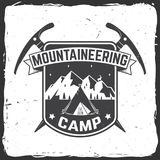 Vintage typography design with ice ax and mountain silhouette. Mountaineering camp badge. Vector illustration. Concept for alpine club shirt or logo, print Royalty Free Stock Images