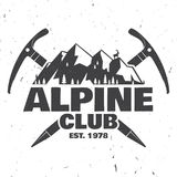Vintage typography design with ice axe, rock climbing Goats and mountain silhouette. Alpine club badge. Vector illustration. Concept for shirt or logo, print Royalty Free Stock Images