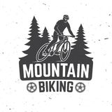 Vintage typography design with man riding bike and forest silhouette. Vector Illustration