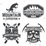 Vintage typography design with mountaineers and mountain silhouette. Stock Image