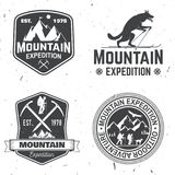 Vintage typography design with mountaineers and mountain silhouette. Stock Photos