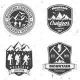 Vintage typography design with mountaineers and mountain silhouette. Royalty Free Stock Images