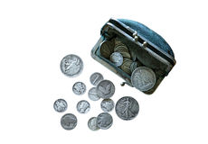 Vintage U.S. Coins and Worn Coin Purse Royalty Free Stock Photos
