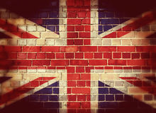 Vintage UK flag on a brick wall. Vintage Union flag on a brick wall with vignette Royalty Free Stock Images