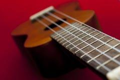 Vintage ukulele. Ukulele on a vintage background Stock Photo
