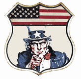 Vintage Uncle Sam. A vintage U.S.A. Flag and halftone image section of Uncle Sam set in a weathered rustic shield badge design Royalty Free Stock Photography