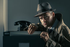 Undercover spy stealing files Stock Photography