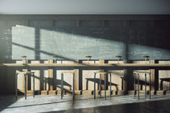 Vintage university classroom with equation solution on blackboar Royalty Free Stock Photo