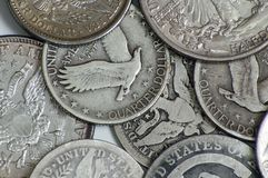 Vintage US coins. Macro photo of vintage US quarters and half dollars showing American eagle Stock Image