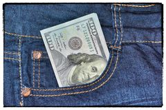 Vintage usd American money is in the pocket of blue jeans Royalty Free Stock Photo