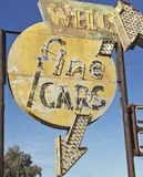 Vintage Used Car Lot Sign. Retro American Route 66 Wells fine cars Motel arrow tivoli lights neon grunge old 1930 1940 1950 rusted Stock Images