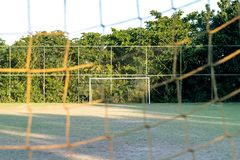 Vintage used soccer posts in park, field is partially covered in the shadow. Trees in the background are in the sun. Rio de Janeir. O, Brazil stock images