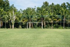 Vintage used soccer posts in park, field is partially covered in the shadow. Trees in the background are in the sun. Rio de Janeir. O, Brazil stock photography