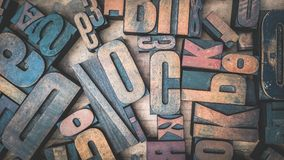 Close Up of Old Used Wooden Typeset Letters stock images