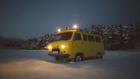 Vintage ussr yellow van winter snow forest. Lights night restauration Royalty Free Stock Image