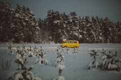Vintage ussr yellow van winter snow forest. Lights night restauration Stock Photos