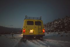 Vintage ussr yellow van winter snow forest. Lights night restauration Stock Photo
