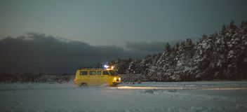 Vintage ussr yellow van winter snow forest. Lights night restauration Stock Image