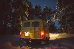 Vintage ussr yellow van winter snow forest. Lights night restauration Royalty Free Stock Images