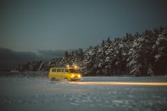 Vintage ussr yellow van winter snow forest. Lights night restauration Stock Images