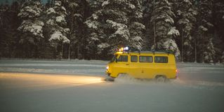 Vintage ussr yellow van winter snow forest. Lights night restauration Stock Photography
