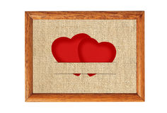 Vintage Valentine card in the form of red paper hearts on fabric Stock Photography