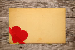 Vintage valentine card with red heart Stock Image