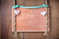 Vintage Valentine frame background with hearts hanging on rope royalty free stock photo