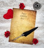Vintage Valentine`s Day card with red cuddle heart and roses, ink and quill - top view stock photo
