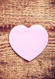 Vintage Valentines Day Card with paper heart on rustic wooden ba Stock Image