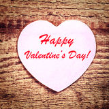 Vintage Valentines Day Card with paper heart on rustic wooden ba Royalty Free Stock Photo