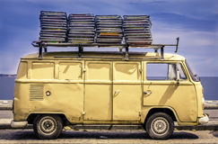 Vintage van in the beach of Ipanema. With chairs on the roof Royalty Free Stock Photography
