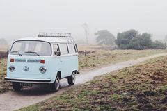 Vintage van on foggy road Royalty Free Stock Image