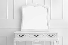 Vintage vanity table set with three drawers and mirror Stock Image