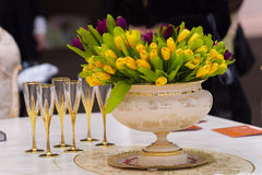 Vintage vase with tulips and champagne glasses Stock Image