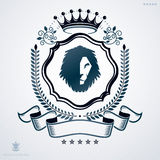 Vintage vector emblem made in heraldic design with lion head  Royalty Free Stock Photography