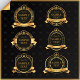 Vintage vector set of black frame label with gold  Stock Images